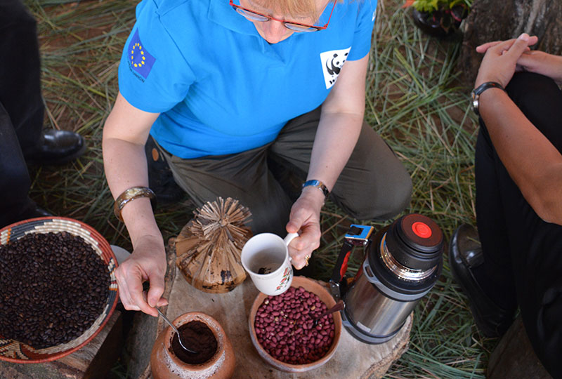 French-envoy-to-Uganda-tastes-coffee-at-village-project-rwenzori+travel with+Kwezi+Outdoors