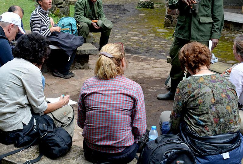 Journalists interview a Uganda Wildlife Authority ranger+travel with+Kwezi+Outdoors